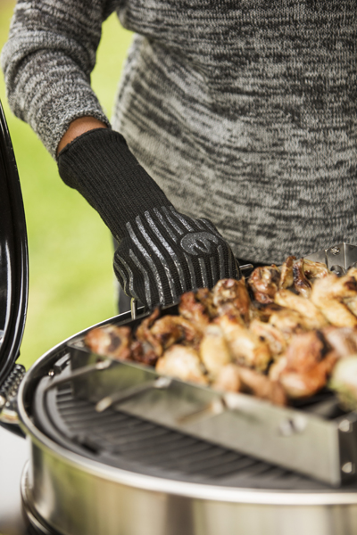 woman using grilling gloves on grill